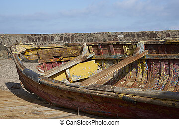 Derelict Boat - Derelict wooden boat on the quayside in the...