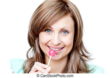 Attractive woman holding a lollipop