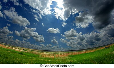 Field with Clouds Timelapse - beautiful spring clouds above...