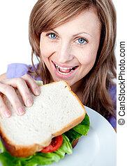 Beautiful woman holding a sandwich