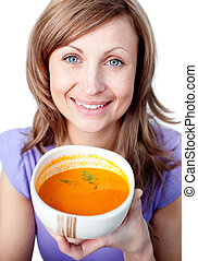 Happy woman holding a soup bowl