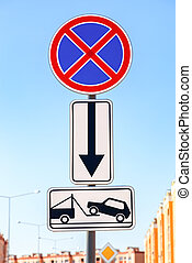 Traffic sign prohibiting parking Evacuation on tow truck