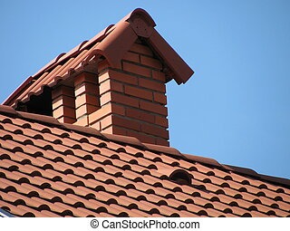 tiled roof over blue sky