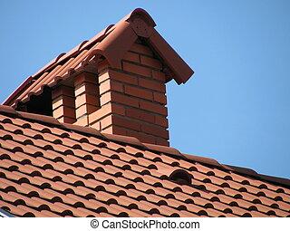 tiled roof over blue sky