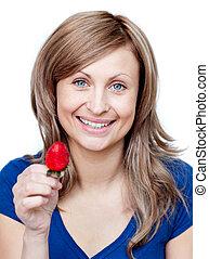 Beautiful woman eating strawberries