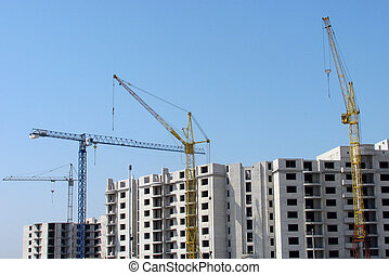 construction area - several building cranes on a...