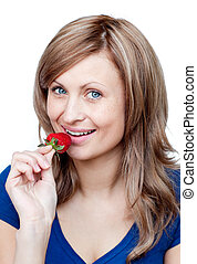 Radiant woman eating strawberries