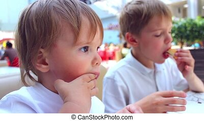 the children eat in a fast food restaurant - kids eat French...
