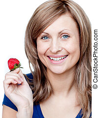 Lively woman eating strawberries against a white background