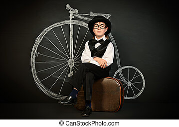 time travel - Elegant boy in a suit, bowler hat and glasses...