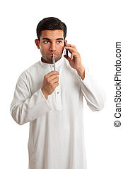 Worried ethnic man on phone - Worried troubled thinking...