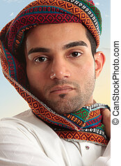 Arab man wearing turban - Arab man wearing a colourful wovan...