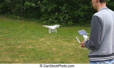 Man controls quadrocopters in slow motion