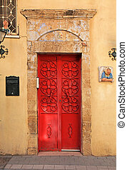 Red antique door in Tel Aviv, Israel