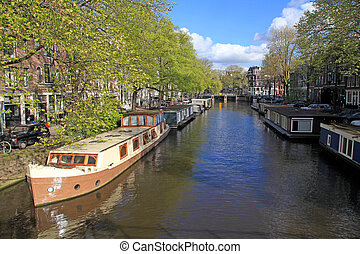 city view with canal, houseboats and traditional houses, Amsterdam
