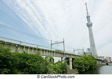 Japan tower, building river, train track with sky
