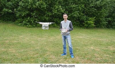 Man controls quadrocopters