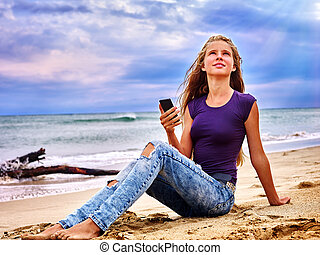 Girl on sand near sea call help by phone - Teenager on sand...