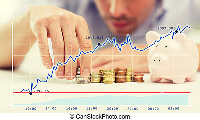 close up of businessman with piggy bank and coins -...