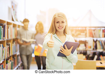 happy student girl with tablet pc in library - people,...