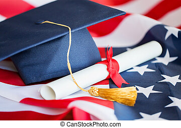 bachelor hat and diploma on american flag - education,...