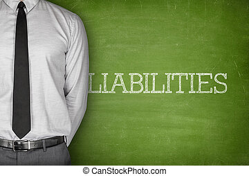 Liabilities text on blackboard - Accounting concept on...