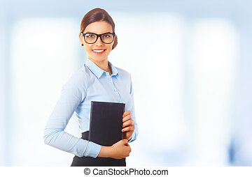 Portraitof happy smiling young cheerful businesswoman in...