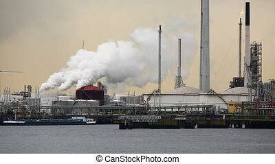 Refinery and power plants emitting smoke and steam