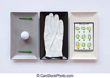 Different ceramic dishes with golf equipments