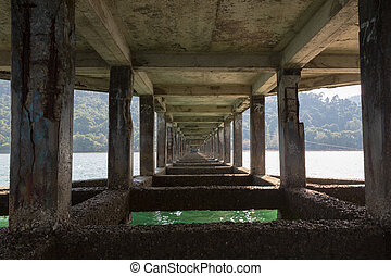 Details of pier in Koh Chang island with ocean. Thailand -...