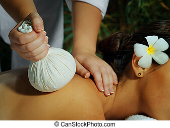 massage time - portrait of young beautiful woman in spa...