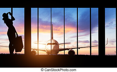 Woman silhouette at Airport - Concept of travel - Young...