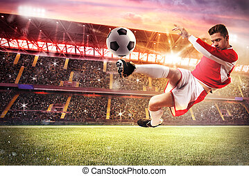 Football game at the stadium - Football player play in a...
