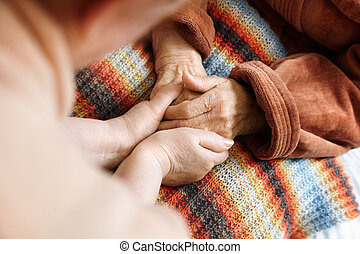 helping hands - adult helps senior in hospital,selective...