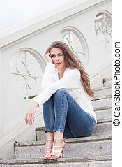 young woman on stairs