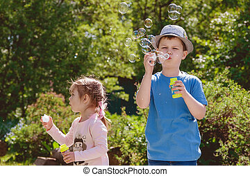 Cute Children are Playing in Park