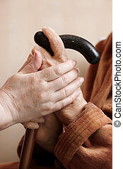 Adult helping senior in hospital - Help concept with hands...