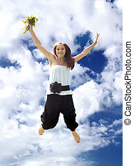 Young woman in jump - Young woman with bouquet in jump