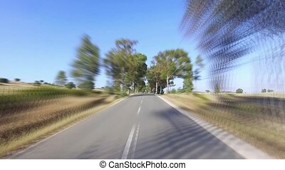 Speedy Driving on a Road in Countryside, sunny weather