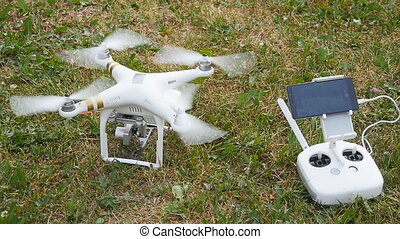 Drone stands on grass - Drone and controller stands on grass