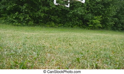 Flying helicopter landing - Flying helicopter with camera...