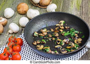 Sautéed Brown and White Champignon Mushrooms with Parsley on...