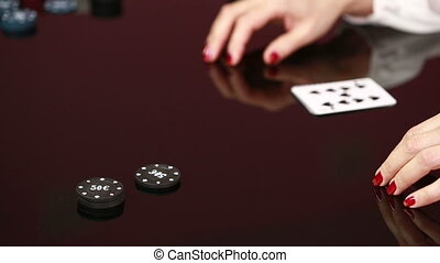 dealer handling playing cards at a poker table Black...