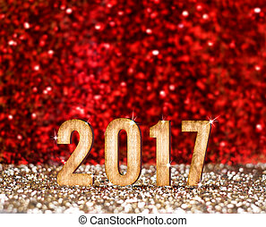 Happy New 2017 year in red and gold glitter background,...