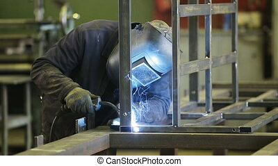 Welder at work - Welder working a welding metal with...