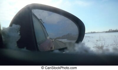 Mirror of the car in Early spring in slowmotion 1920x1080 hd...