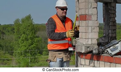 Builder using measuring tape