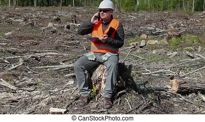 Environmental inspector talking on smart phone in the...