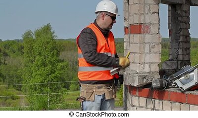 Builder works with chisel and hammer