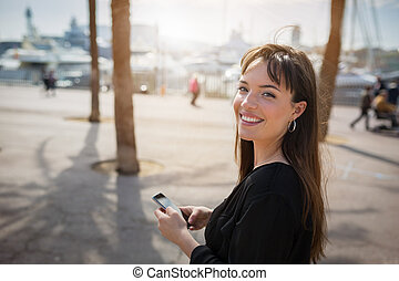 Happy pretty woman - A photo of young, beautiful woman using...